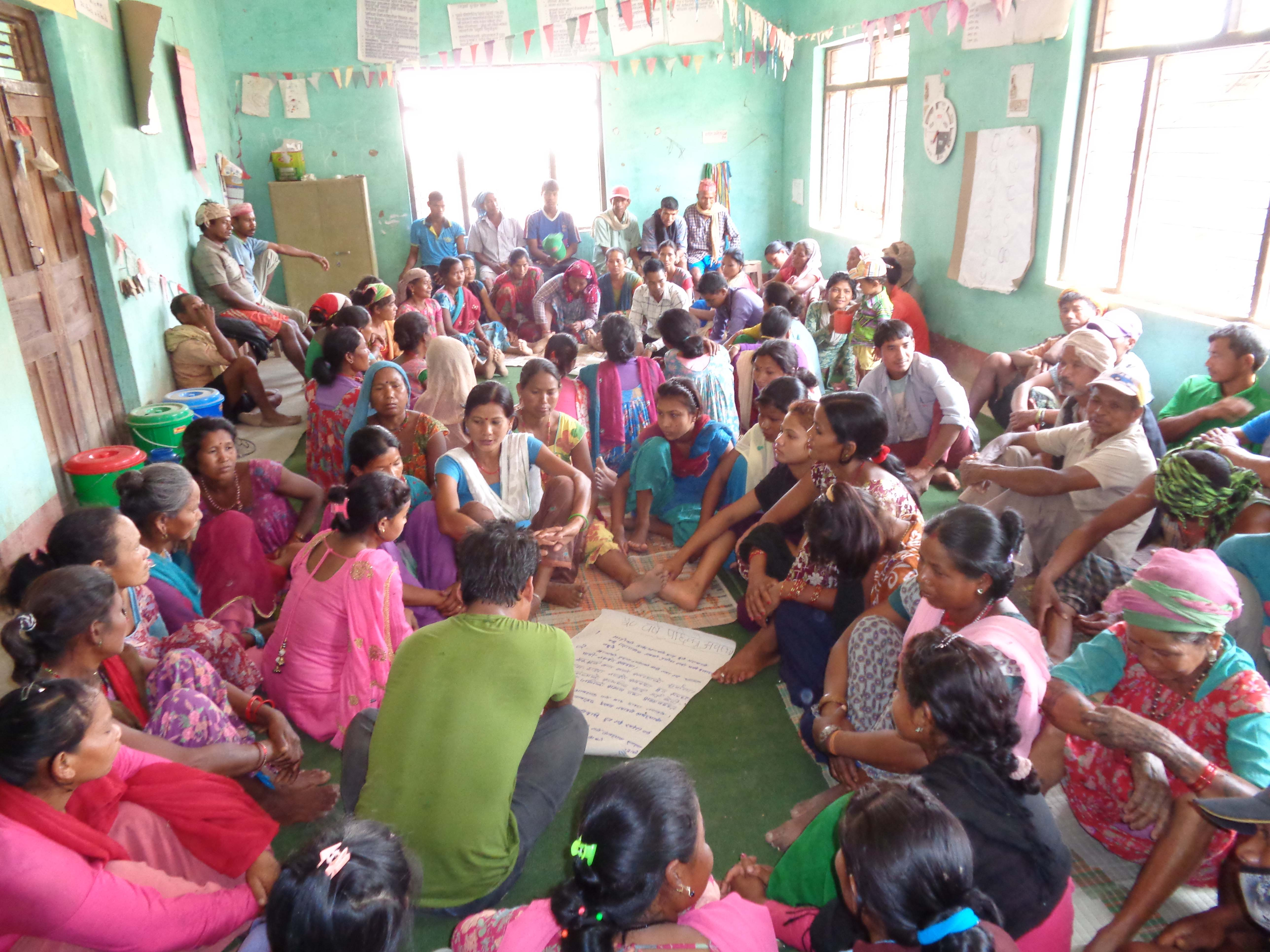 Women in Padanaha community, Bardiya  District, Nepal discuss community bylaws, led by the Community Self-Reliance Centre (CSRC).