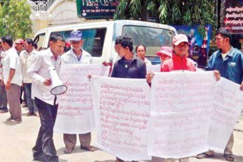 Protesters demonstrate against land rights NGO Equitable Cambodia in Phnom Penh earlier this month.