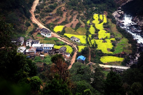 Salme Village beside the Solu River, on the right is the newly built bridge over the river. It is located in Nuwakot District, Nepal. Asian Development Bank.