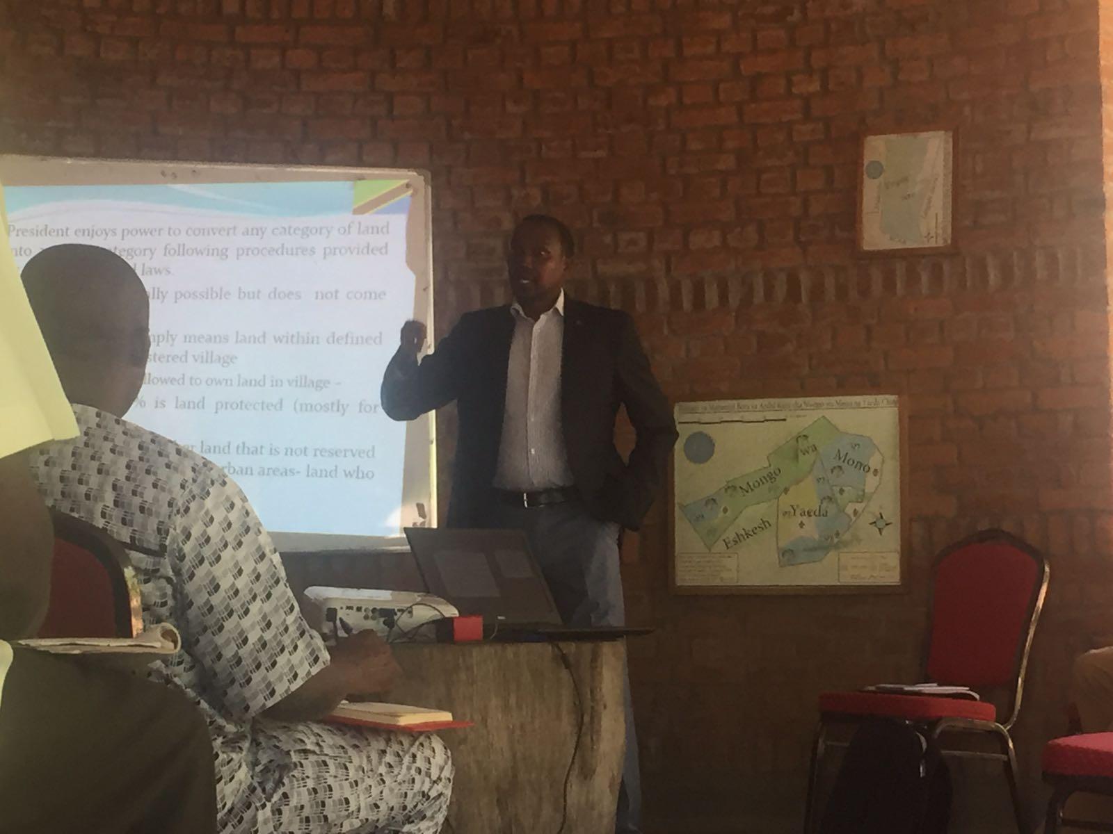 Edward Lekaita of UCRT presenting the legal framework on land tenure in Tanzania