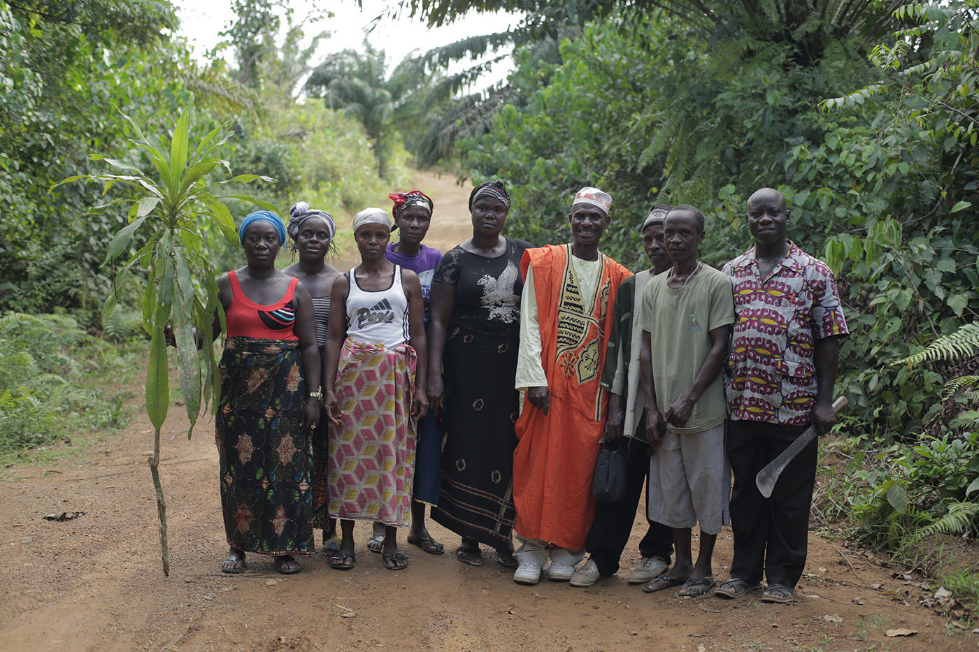 Community members in Siahn, Rivercess County, Liberia, prepare to meet with their neighbors to plant a boundary tree, supported by the Sustainable Development Institute (SDI).