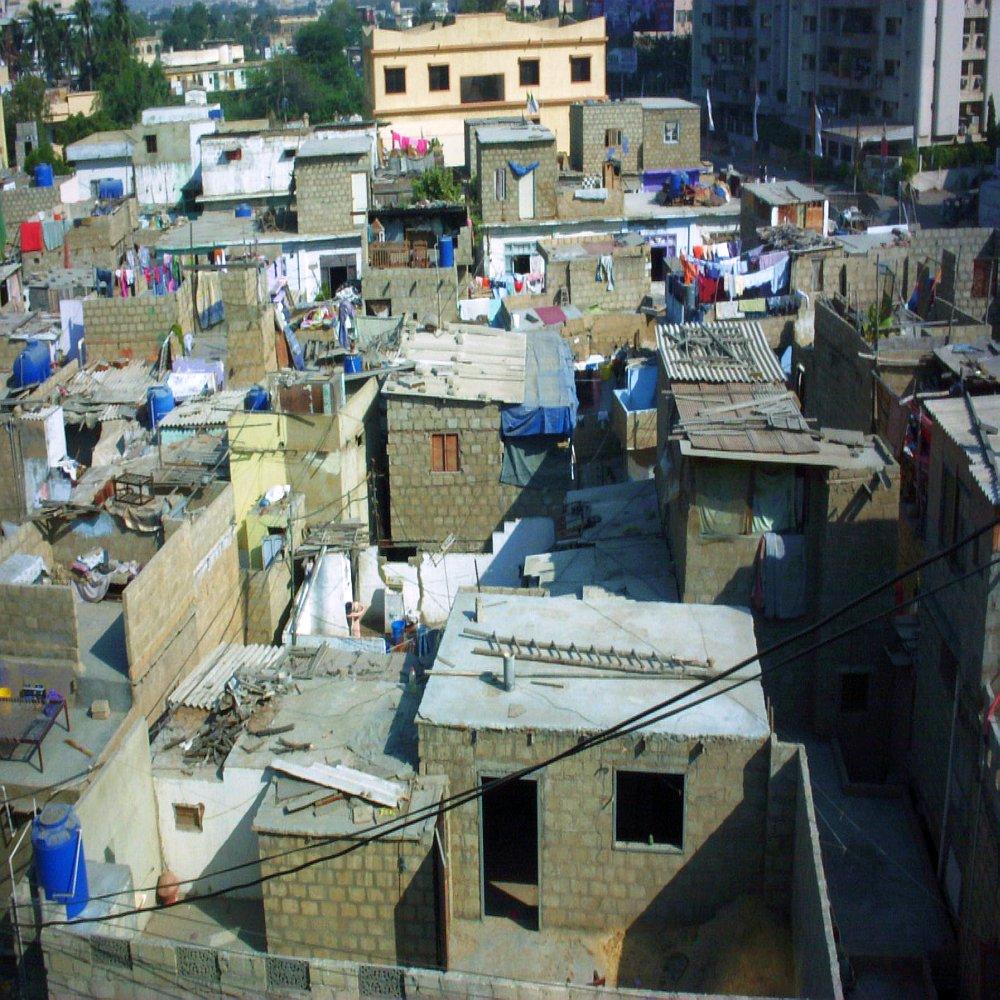 A slum inside Karachi Pakistan, next to upscale Race Course neighborhood, photo by کراچی برنامج No Real Name Given AKA دانلود سكس, Photo licensed under the Creative Commons Attribution-Share Alike 2.0 Generic license