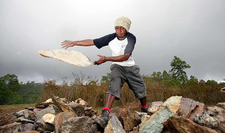 Domingus Asep Soares throws rocks into the cliff to build retention walls to assist with the erosion in Eraulo west of Dili. Asian Development Bank, 2011. CC BY-NC-SA 2.0