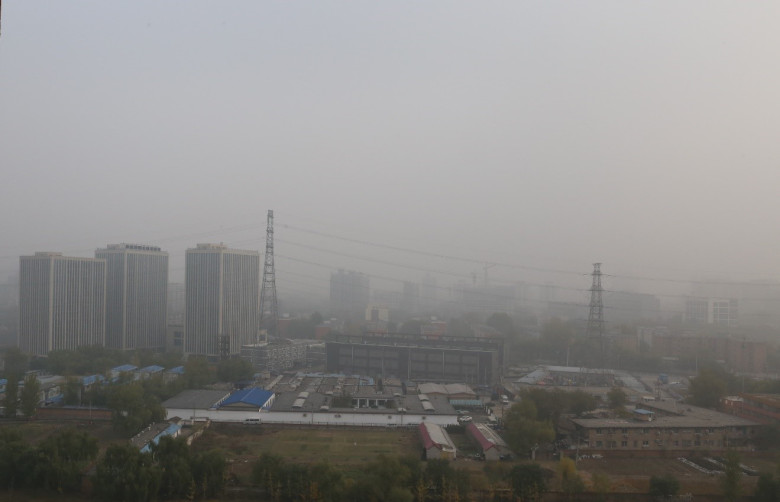 Figure 1. A typical smoggy day in Beijing, taken at noon on 11/14/2015. Low-rise buildings at the front are part of a village within city. Image Credit: Yanfei Pu