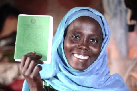 An Ethiopian female farmer with a land certificate