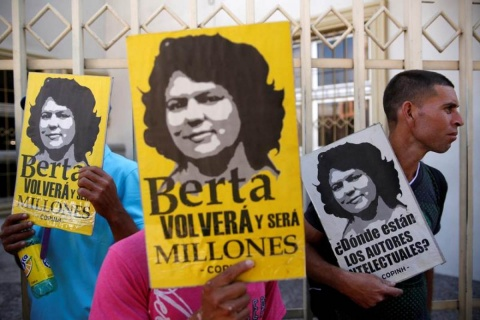 "Indigenous people protest outside a court during a hearing of Roberto David Castillo, arrested on charges of helping plan the murder of Berta Caceres, in Tegucigalpa, Honduras March 3, 2018. Placard reads: ""Berta will come back again and she will be milli"