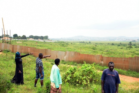 Residents point at a contested 154 acre-peice of land at Kitiko-Birongo, Wakiso District, on the Entebbe Express Highway in 2019. PHOTO/ DAVID LUBOWA
