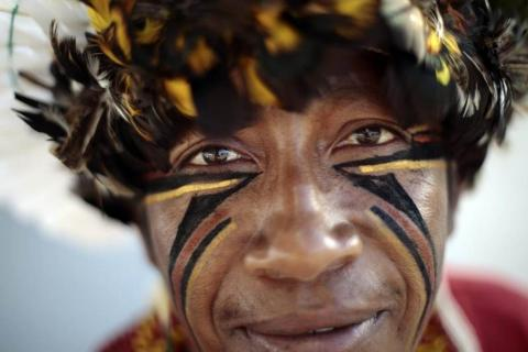 A Pataxo Indian living in Bahia, in northeastern Brazil, is seen near the Esplanade of Ministries in Brasilia March 12, 2014. The Indians are in Brasilia for meetings with authorities to discuss health needs and conflict issues between Indians and farmers