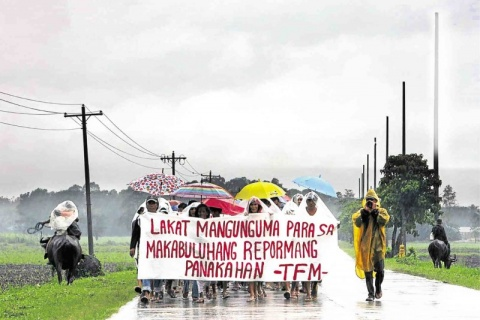 FARMERS from haciendas in the southern part of Negros Occidental march in Isabel town to call for a meaningful agrarian reform. LYN RILLON