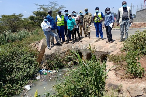 A team from Nema enforcement and KWS at the point where raw sewer pollutes the park Image: COURTESY