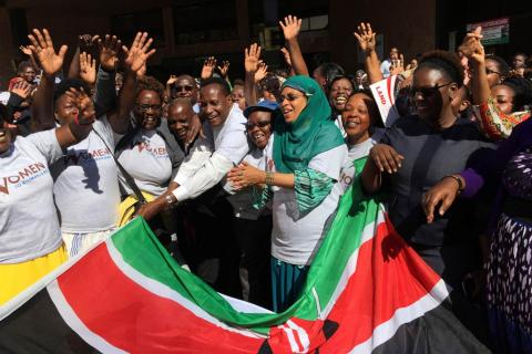 13 October, 2016Kenya's Lands Minister Jacob Kaimenyi (5th L) and Mariamu El Maawy (7th L), principal secretary in the Lands and Physical Planning Ministry, flag off a bus of women who will climb Mount Kilimanjaro as part of a campaign for land rights in