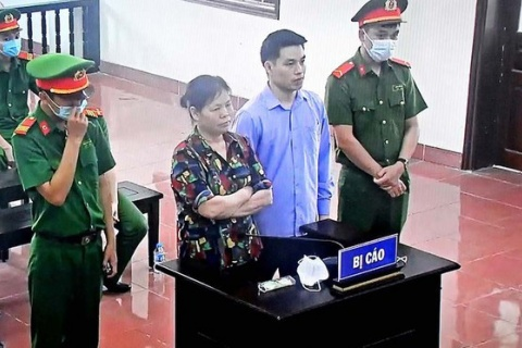 Vietnamese Mother, Son Draw Eight-Year Prison Terms for Land-Rights Activism