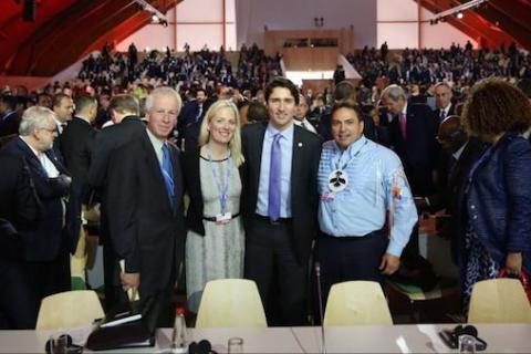 Prime Minister Justin Trudeau with Minister of Foreign Affairs Stéphane Dion, Minister of Environment and Climate Change Catherine McKenna, and AFN National Chief Perry Bellegarde at the COP21 climate talks in Paris.
