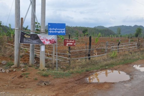 """Land is not commodity"" VFVL law campaign poster in Kayah State"