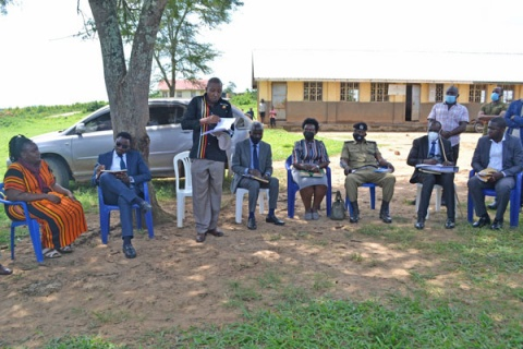 Gomba RDC Steven Asiimwe (standing third left) addresses stakeholders about the giveaway of forest reserves on Tuesday. PHOTO | BRIAN ADAMS KESIIME.