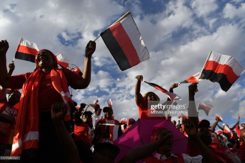 Botswana Democratic Party (BDP) supporters wave flags during an election campaign rally in Mokgweetsi Masisi's, President of Botswana and leader of the BDP, home village in Moshupa