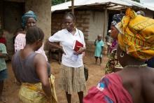 A paralegal speaks with community members in Mamusa community, Sierra Leone.